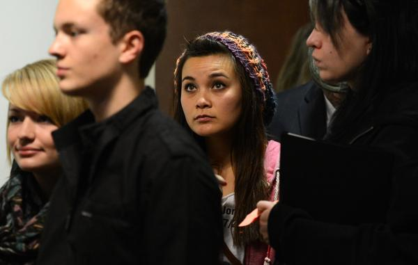 Chantel Blunk, center, wife of Jonathan Blunk arrive for court, Monday morning, January 7, 2013, in Centennial. (RJ Sangosti, The Denver Post)