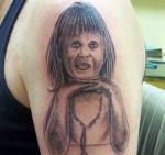 3929554976 bd91a10043 150x141 15 Really, Really, Really Bad Tattoos