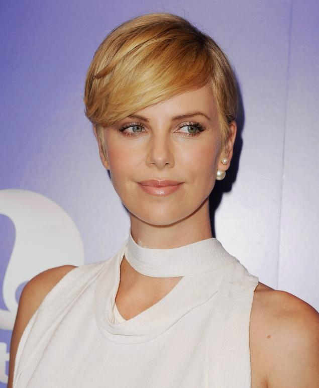 Charlize Theron Hides Bandages On Red Carpet After Neck Surgery