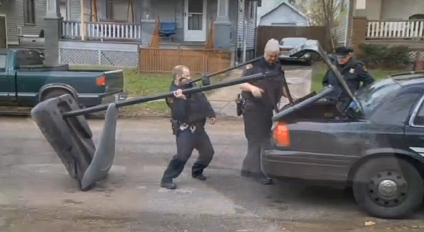 Cops confiscate basketball hoop, drag it away sadly