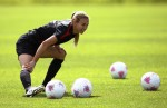 Mitts from U.S. women's Olympic soccer team stretches during a training session ahead of the London 2012 Olympic Games, in Stepps