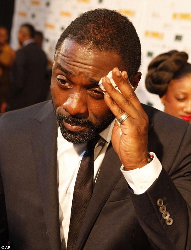 Idris Elba sweating