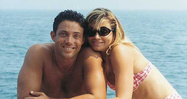 Fraudster, Jordan Belfort (L) with his second wife, blonde Mille