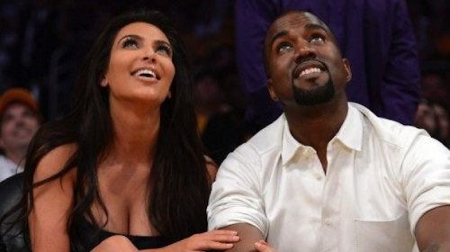 Kim-Kardashian-and-Kanye-West-watch-the-video-board-from-their-courtside-seats-at-the-Staples-Center-as-the-Los-Angeles-Lakers-take-on-the-Denver-Nuggets-during-the-NBA-Playoffs-on-May-12-2012.-AFP