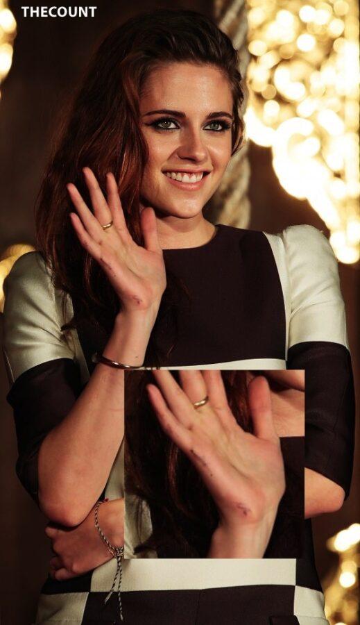 Kristen Stewart leggy in shorts 01 560x972 KRISTEN STEWART TOKYO TWILIGHT   Mystery Dirty Hands
