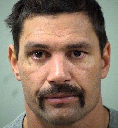 Manu Bennett arrested mugshot