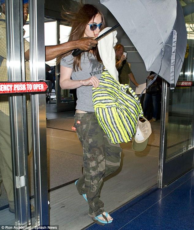Megan Fox hides baby bump