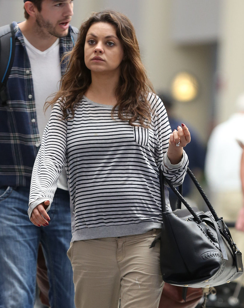 Mila-Kunis-Shows-Baby-Bump-Airport-Ashton-Kutcher-1