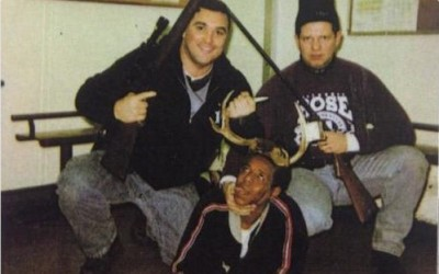 Photo Cops Posing With Black Man Forced To Wear Antlers 400x250 PHOTO: Cops Force Black Man To Pose As Their Kill Wearing Antlers
