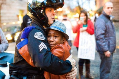 Photo Of Boy Hugging Cop STAGED