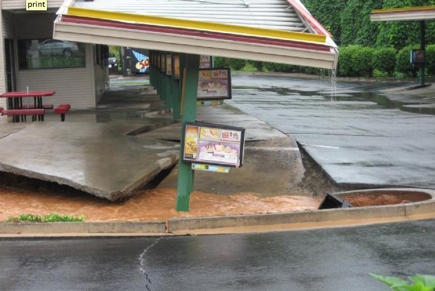 sinkhole gobbles up fast food restaurant