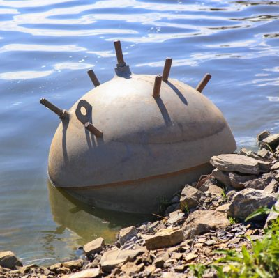 army sea mine on water near the coast