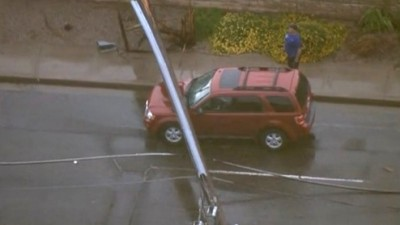 Power Poles Come Down On Cars In Phoenix 2 400x225 String Of Power Poles Come Down On Cars In Phoenix, AZ Area Flooding