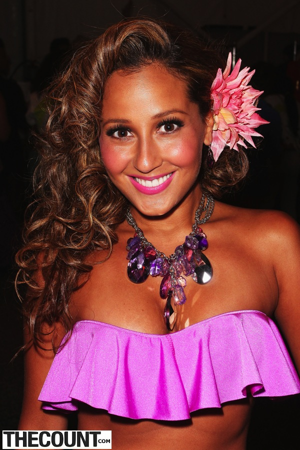 Adrienne Bailon poses backstage at the Nicolita show  during Merecedes-Benz Fashion Week Swim 2012 at The Raleigh on July 18, 2011 in Miami Beach, United States.