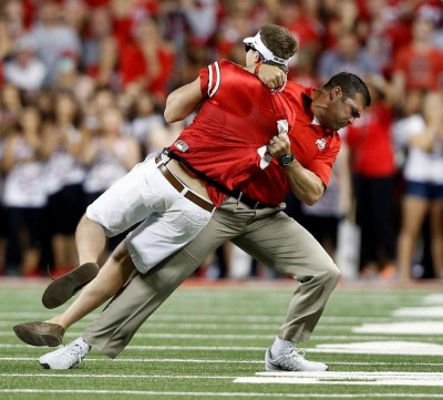 anthony-schlegel-tackles-man-on-field