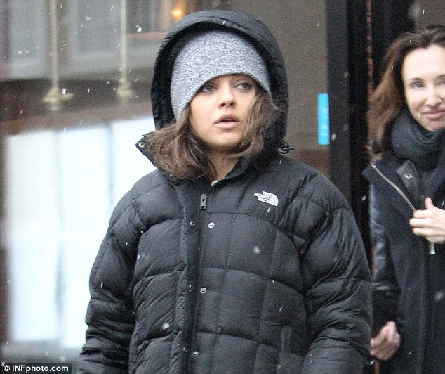 article 0 18E87352000005DC 835 634x532 Mila Kunis Hides From Paps By Covering Her OWN EYES!