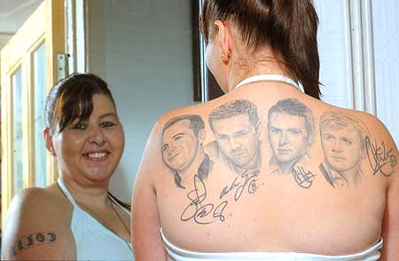 bad band tattoos 7 People Who Dared To Tattoo Music Stars On Their Bodies