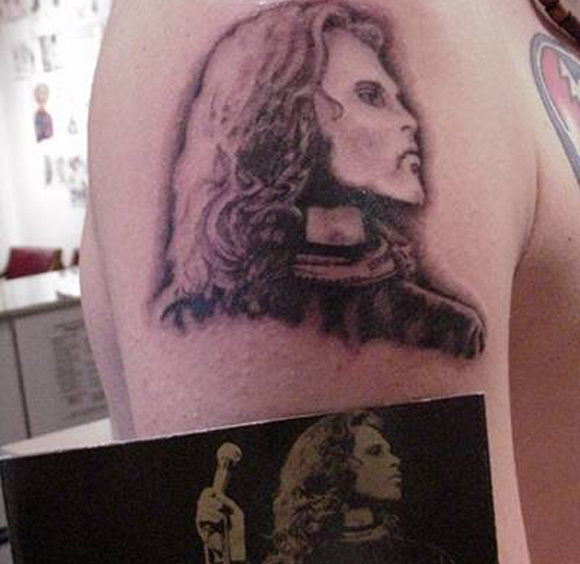 bad band tattoos 8 People Who Dared To Tattoo Music Stars On Their Bodies