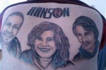 bad band tattoos 9 150x100 People Who Dared To Tattoo Music Stars On Their Bodies