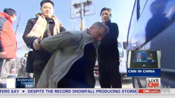 cnn reporter man handeled