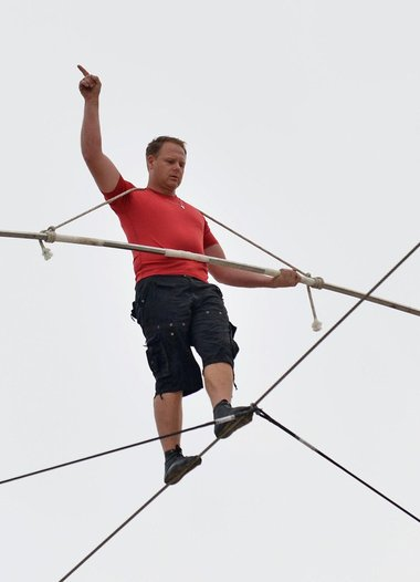 Daredevil Tightrope Walker Crosses FL Highway NO NET!