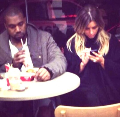 kanye kim burger fat burger 400x390 Check Out This List Of Celebrities Who Own Fast Food Franchises