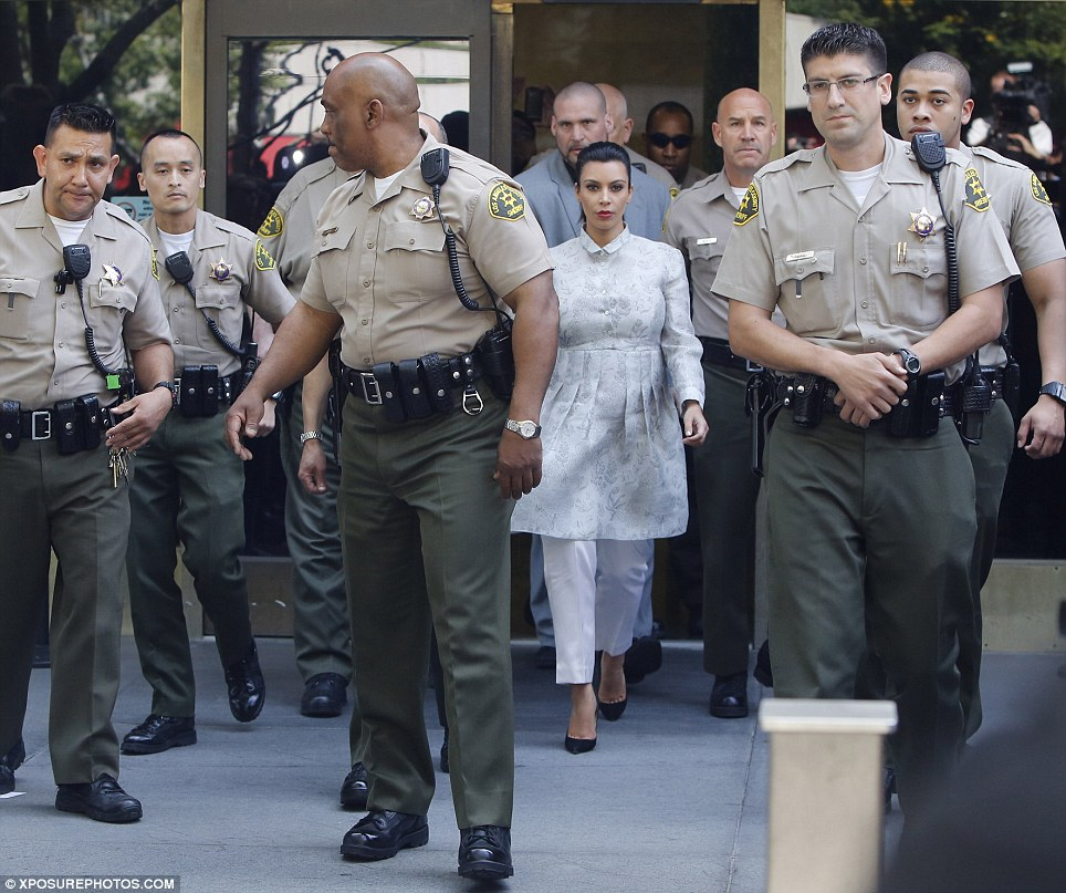 kim ten sheriffs How Many Sheriffs Does It Take To Escort Kim Kardashian Out Of Divorce Court?