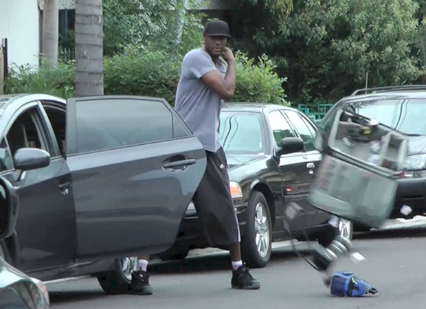 Lamar Odom hits a photographers car with a piece of metal and takes camera gear from another photographers car and then poses for a fan