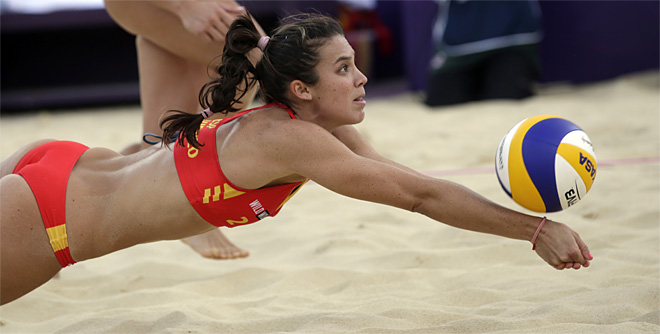 Elsa Baquerizo of Spain digs out a ball during a beach volleyball match against the United States at the 2012 Summer Olympics, Thursday, Aug. 2, 2012, in London. (AP Photo/Dave Martin)