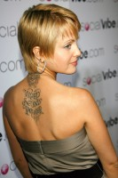 mena1 133x200 AMERICAN BEAUTY: Mena Suvari Tattoos And Freshly SINGLE