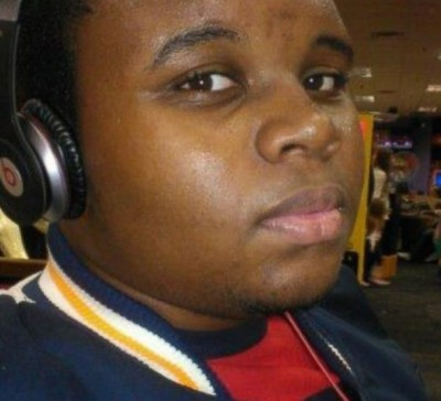 michael brown stealing cigars 400x364 Mike Brown Bestie In Critical Condition After SHOT By Ferguson Cops