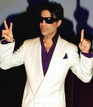 Prince gestures during a press conference in London.