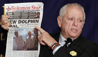 "Former dolphin-trainer Ric O'Barry speaks while showing a newspaper reporting about his action during a press conference at the Foreign Correspondents' Club of Japan in Tokyo, Japan, Monday, Sept. 6, 2010. O'Barry, the star of the Oscar-winning documentary ""The Cove"" about the Japanese dolphin hunt, said that activists trying to stop the killing might need to back off and allow the Japanese people to tackle the issue themselves. (AP Photo/Shizuo Kambayashi)"