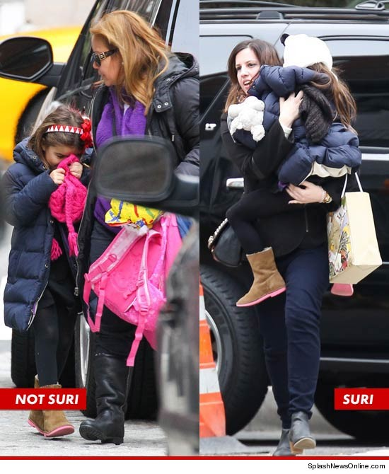 suri cruise double splash 8 Suri Cruise Discovered Using Body Double To Fool Public