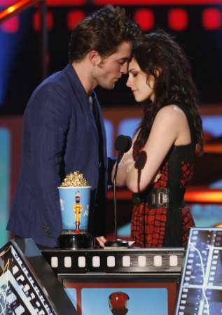 Kristen and Robert accept their award passionately