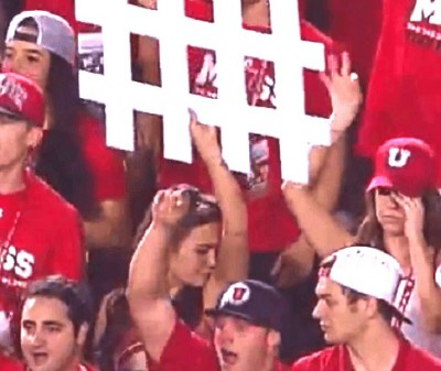 utah fan sniffing armpit 400x337 Football Fan Caught On Camera Sniffing Her Armpit And Its Not Good