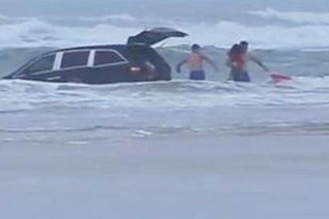 woman drives mini van ocean