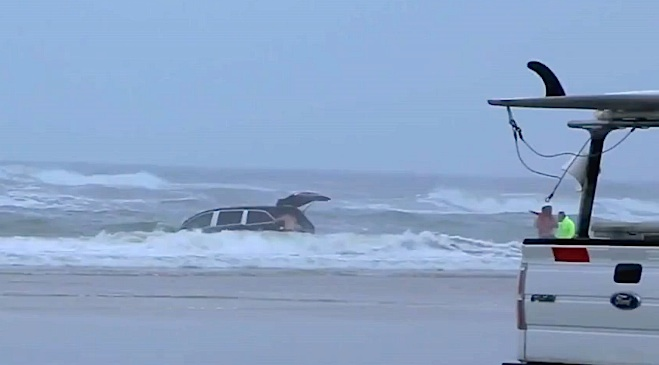 woman drives van in ocean