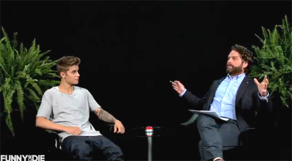 zach-galifianakis-lashes-justin-bieber-with-his-belt-between-two-ferns